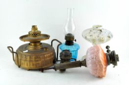 A collection of oil lamps and parts,