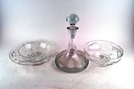 A ship's decanter and stopper, 20th century, together with various cut glass bowls,