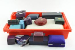 An assorted collection of jewellery boxes and ring mounts