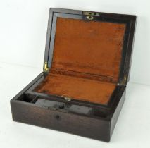 A 19th century rosewood writing slope, with mother of pearl inlay adorning the top,