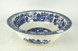 A large blue and white Willow pattern wash bowl by Wedgwood,