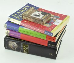 Four Harry Potter books, comprising: a softback 'The Philosopher's Stone',
