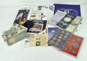A collection of Commemorative coin sets and medals, including a 1953 Coronation coin,