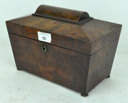 A Victorian mahogany tea caddy of sarcophagus form,
