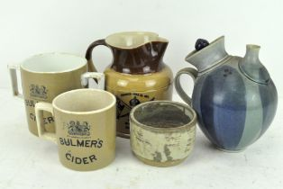 A James Tate and Sons, Wine Merchants, Wells 1911 coronation jug and two Bulmers mugs,