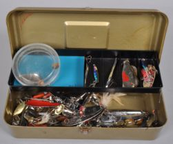 A metal tackle box containing heavy duty spoons,