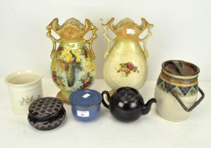A Royal Doulton stoneware biscuit barrel and cover, pair of vases,
