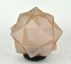 An Art Deco opaque rose tinted glass star shaped lamp shade, with fixture,