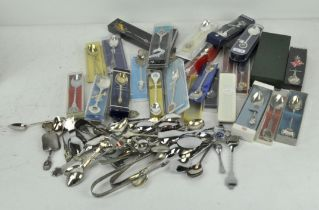 An extensive collection of commemorative teaspoons, mostly silver plated or chrome,