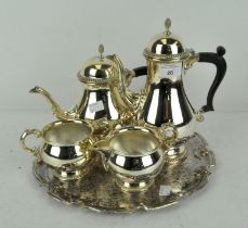 A Barker Ellis silver plated four piece tea set on tray