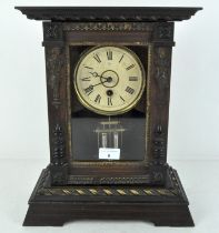 An early 20th century mantel clock by Junghams, the dial with Roman numerals denoting hours,
