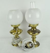 Two oil lamps, one converted to electricity, the other by Duplex, both with original glass shades,