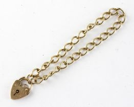 A yellow metal curb link bracelet with padlock clasp. Hallmarked 9ct gold, London, 1978.