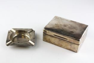 A silver cigarette box of rectangular form, hallmarked London 1935 by SJ Rose,
