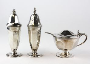 A silver George III style three piece cruet set, comprising: salt, pepper and mustard pot,