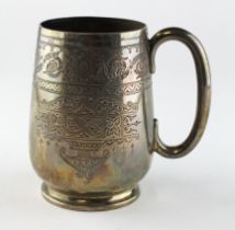 A late Victorian silver mug, highly engraved decoration throughout,