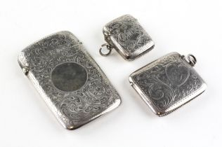 A silver card case and two silver vesta cases,