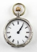 A mid size open face pocket watch. Circular white dial with roman numerals.