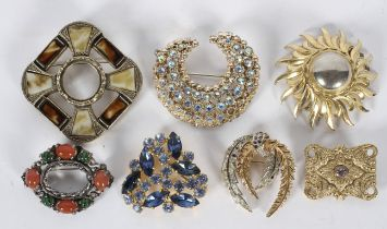A collection of twenty costume brooches of variable designs, gross weight 257 grams.