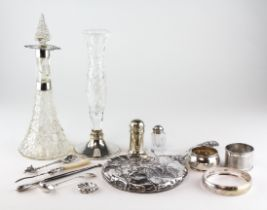 A selection of silver and plated items, silver mounted glass bottle and other items