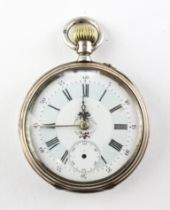 An open face pocket watch. White circular dial with roman numerals and floral design.