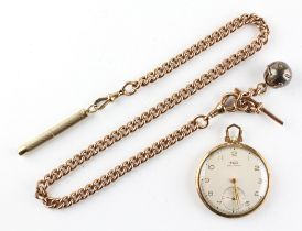 A yellow gold open face Tissot pocket watch. Circular champagne dial with numerical markings.