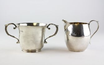 A silver cream jug, hallmarked London, together with a two handled sugar bowl, hallmarked Chester