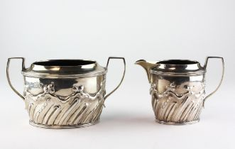 A Victorian silver twin handled sugar bowl with matching cream jug,