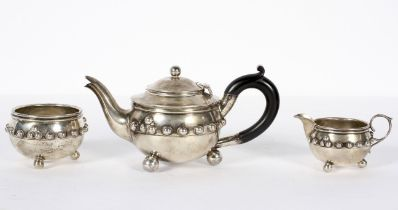 A silver batchelars three piece tea set, moulded on the Glastonbury bowl, of rounded form.