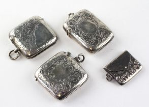 Three silver vesta cases, each with engraved foliate motifs,
