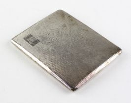 A mid century cigarette case of rectangular form with engine turned decoration throughout,