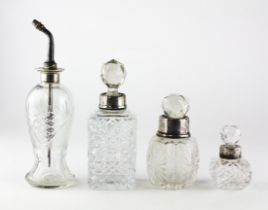 Two silver topped cut-glass sent bottles,