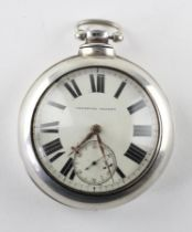 A large Victorian sterling silver open face pocket watch. Circular white dial with roman numerals.
