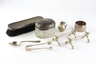 An assortment of silver and silver plated items, to include a set of sugar tongs, spoon,