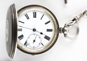 A full hunter pocket watch. Circular white dial with roman numerals.