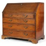 A George III mahogany bureau, the fall front revealing interior fitted with pigeonholes,