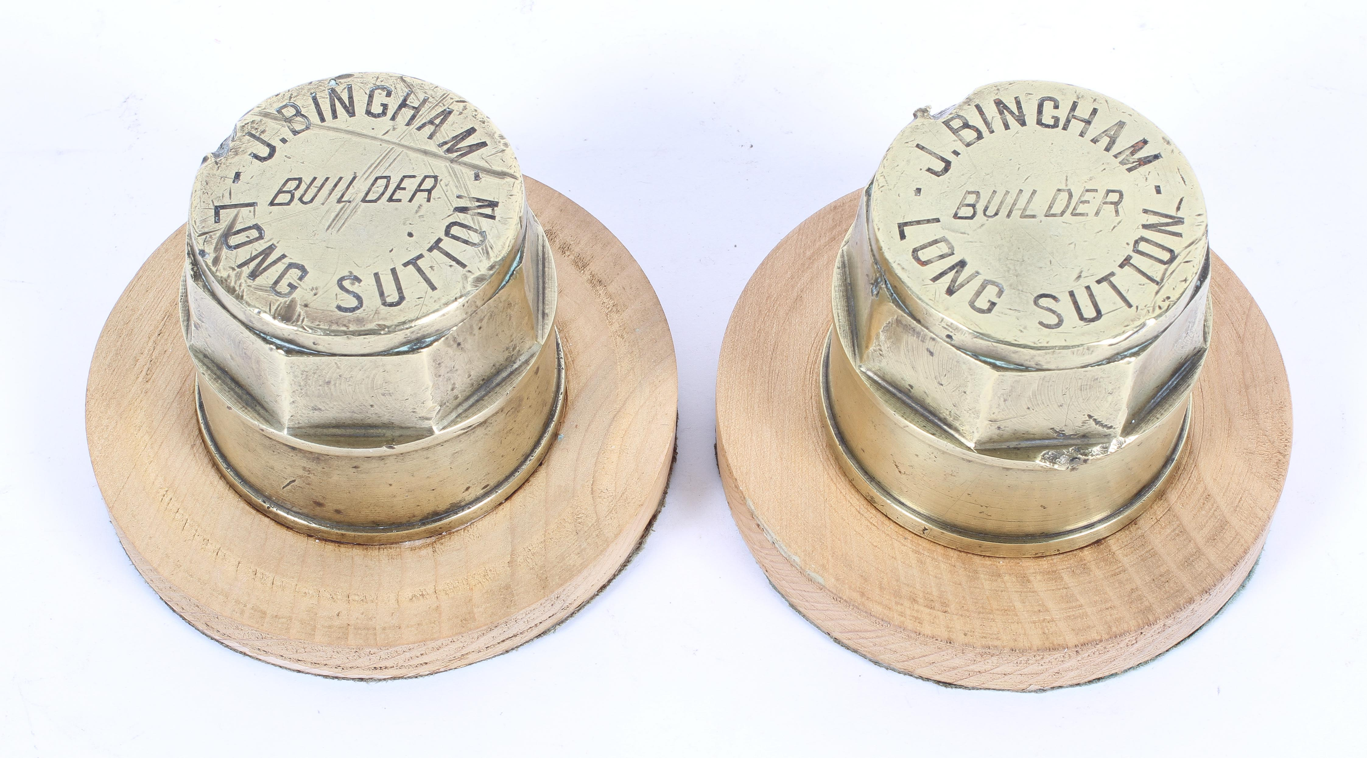 Two brass hub caps mounted as paperweights, by J Bingham, Builder, Long Sutton,