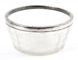 An Edwardian silver-mounted cut glass bowl, panel cut and cut with linear bands,