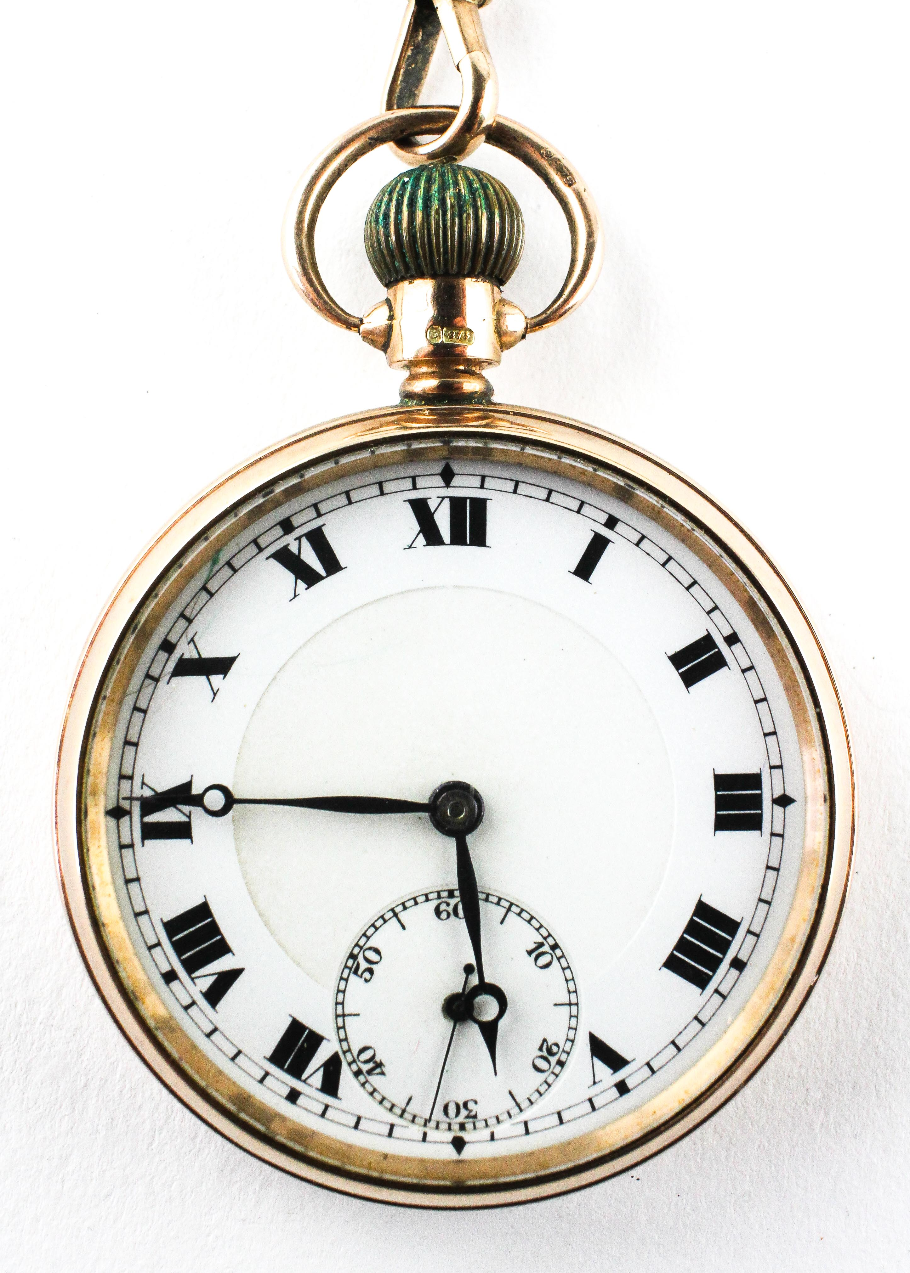An open face pocket watch. Circular white dial with roman numerals.