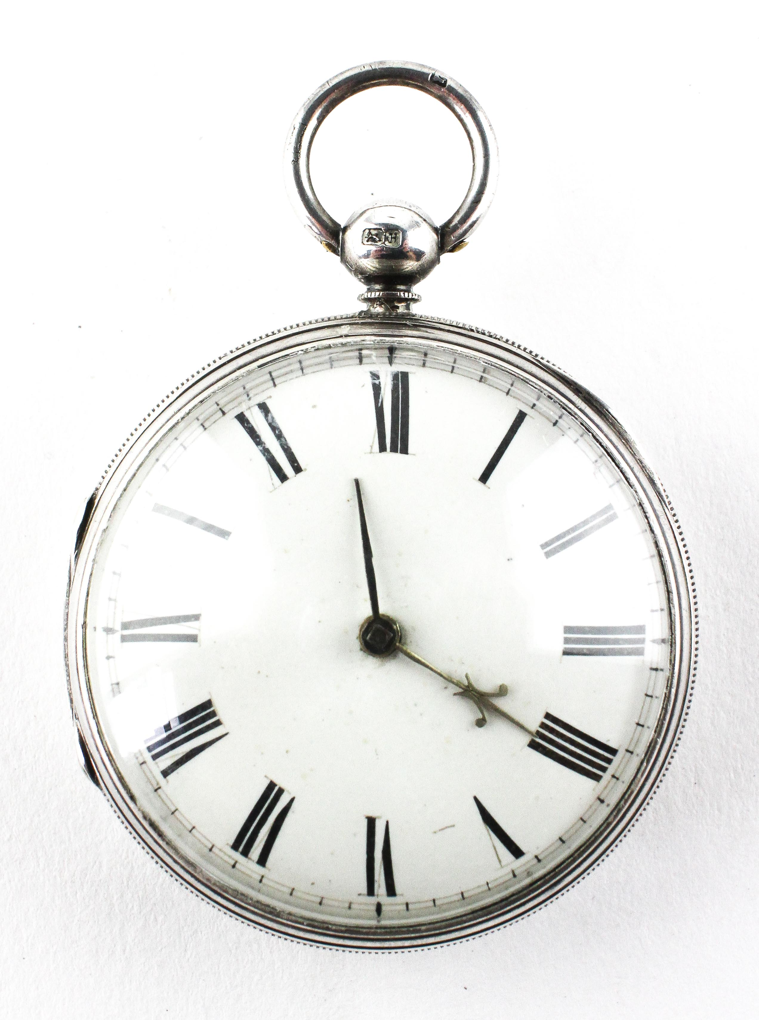 A large open face pocket watch. Circular white dial with roman numerals. Key wound movement.