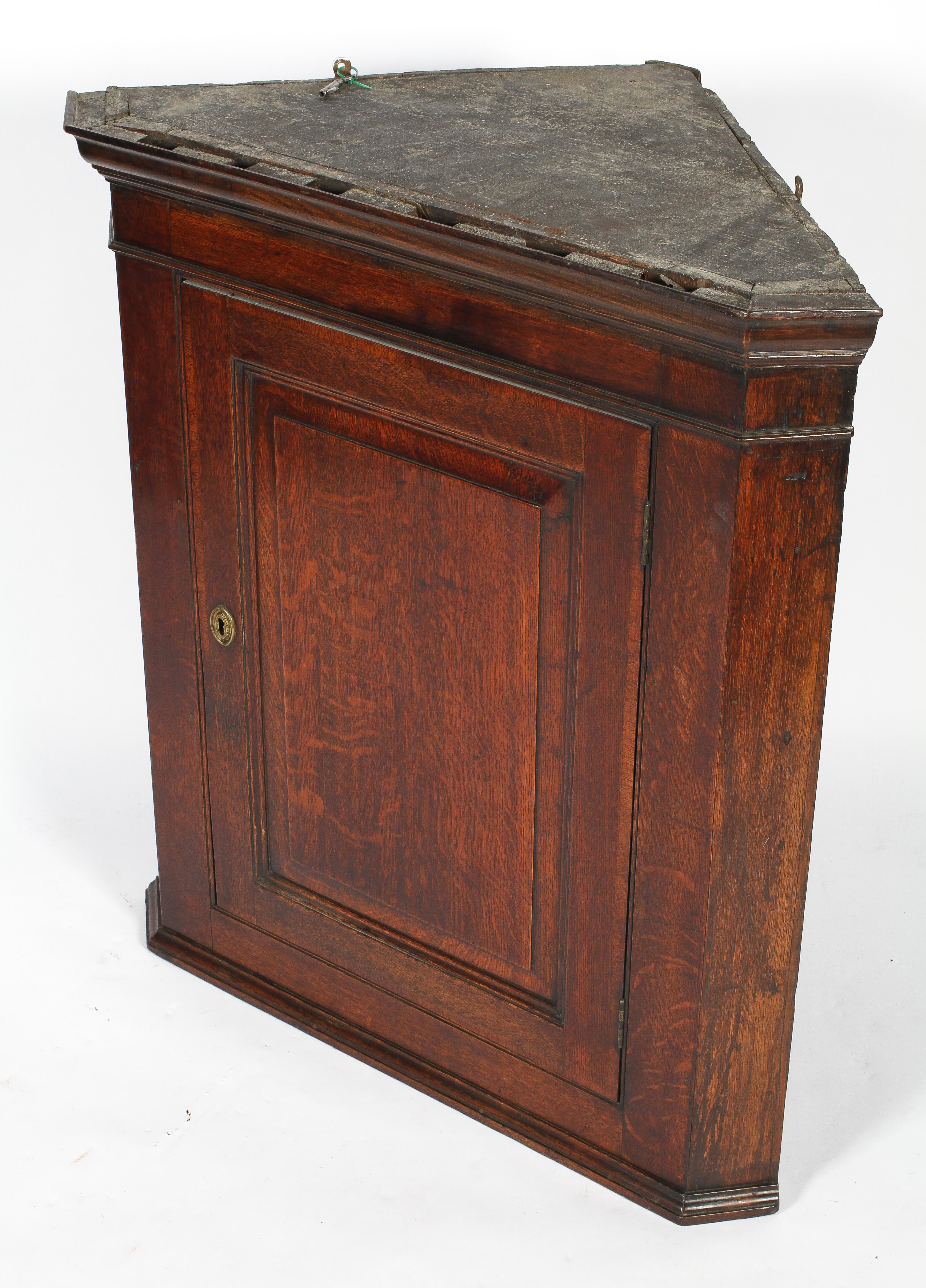 An 18th century oak corner cupboard, with moulded cornice and panelled door, - Image 2 of 2