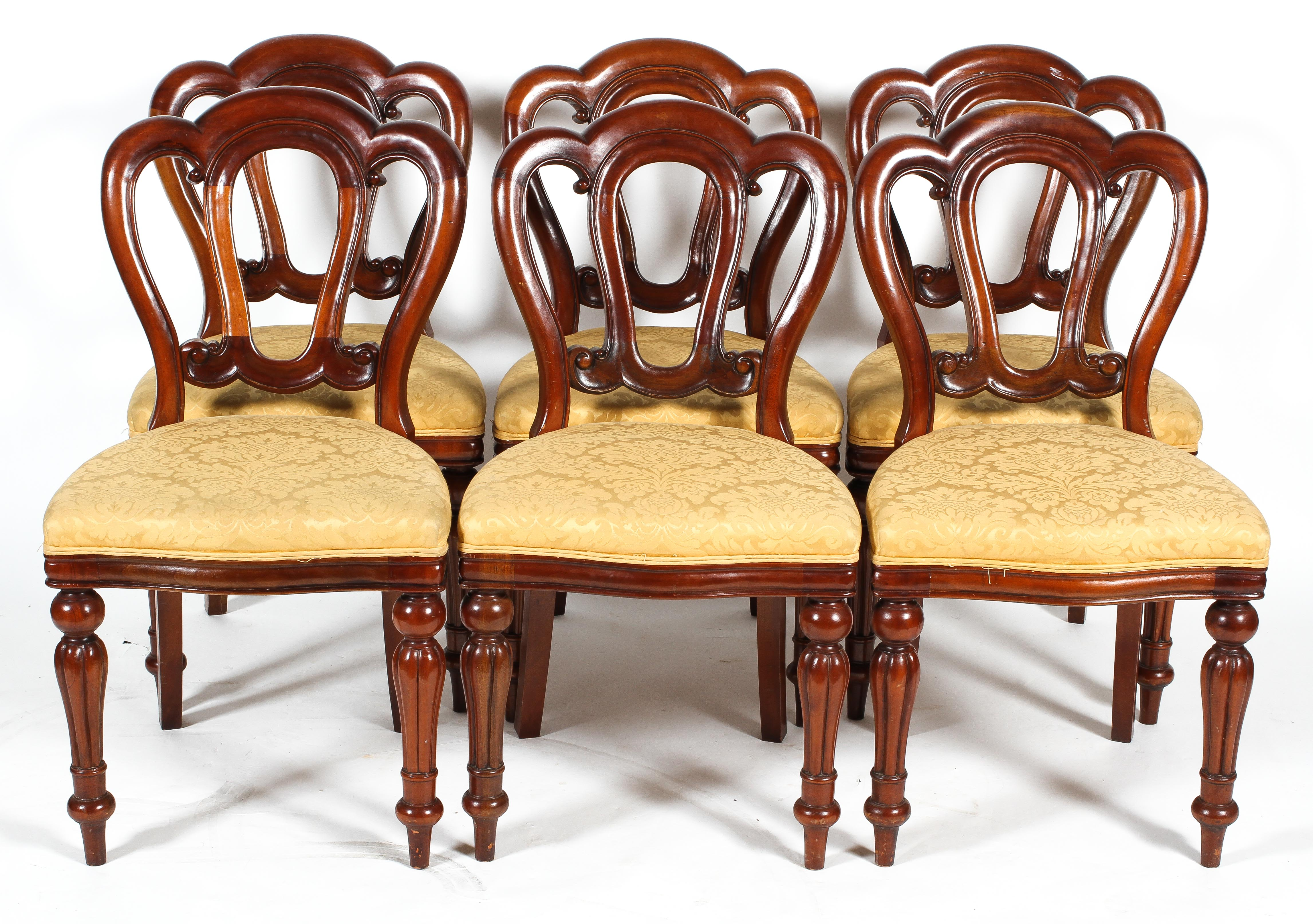 A set of six Victorian style mahogany balloon back dining chairs, with triple arched backs,