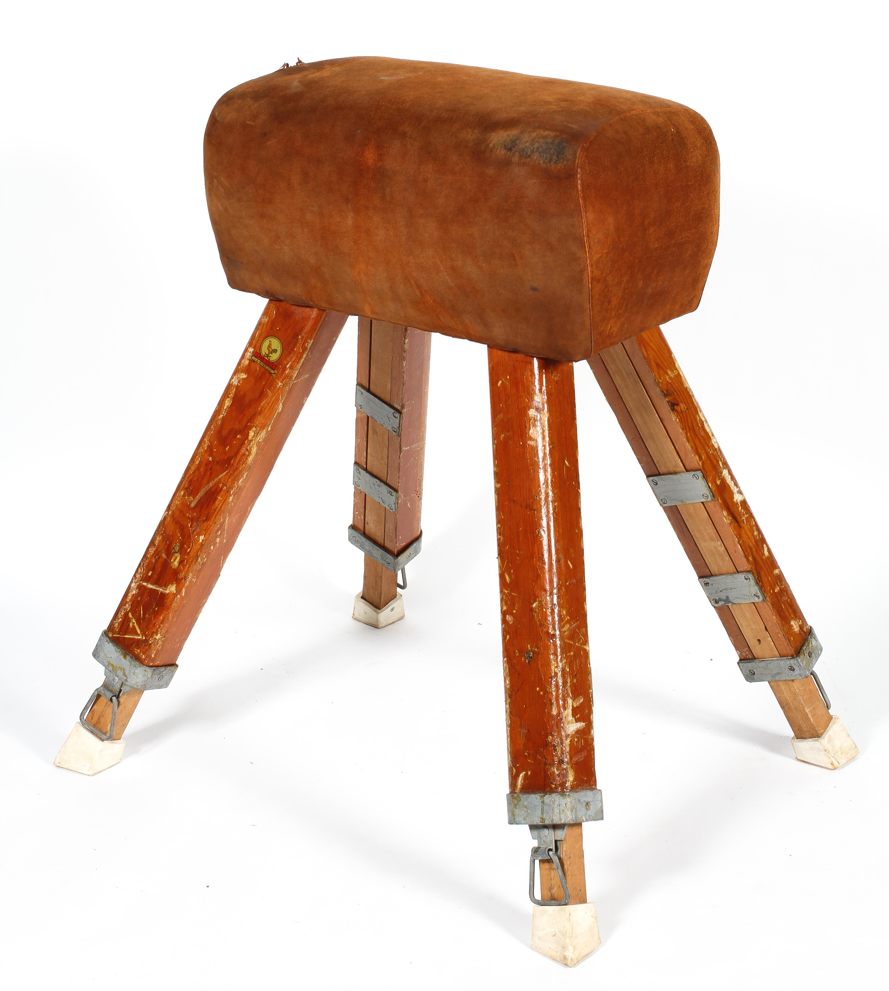 A vintage pommel horse by IE Bliss Ltd, in tan suede, on splayed legs, bearing yellow label,
