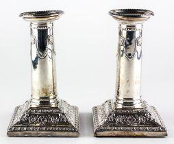 A pair of Edward VII silver candlesticks,