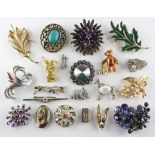 A collection of twenty one costume brooches of variable designs.