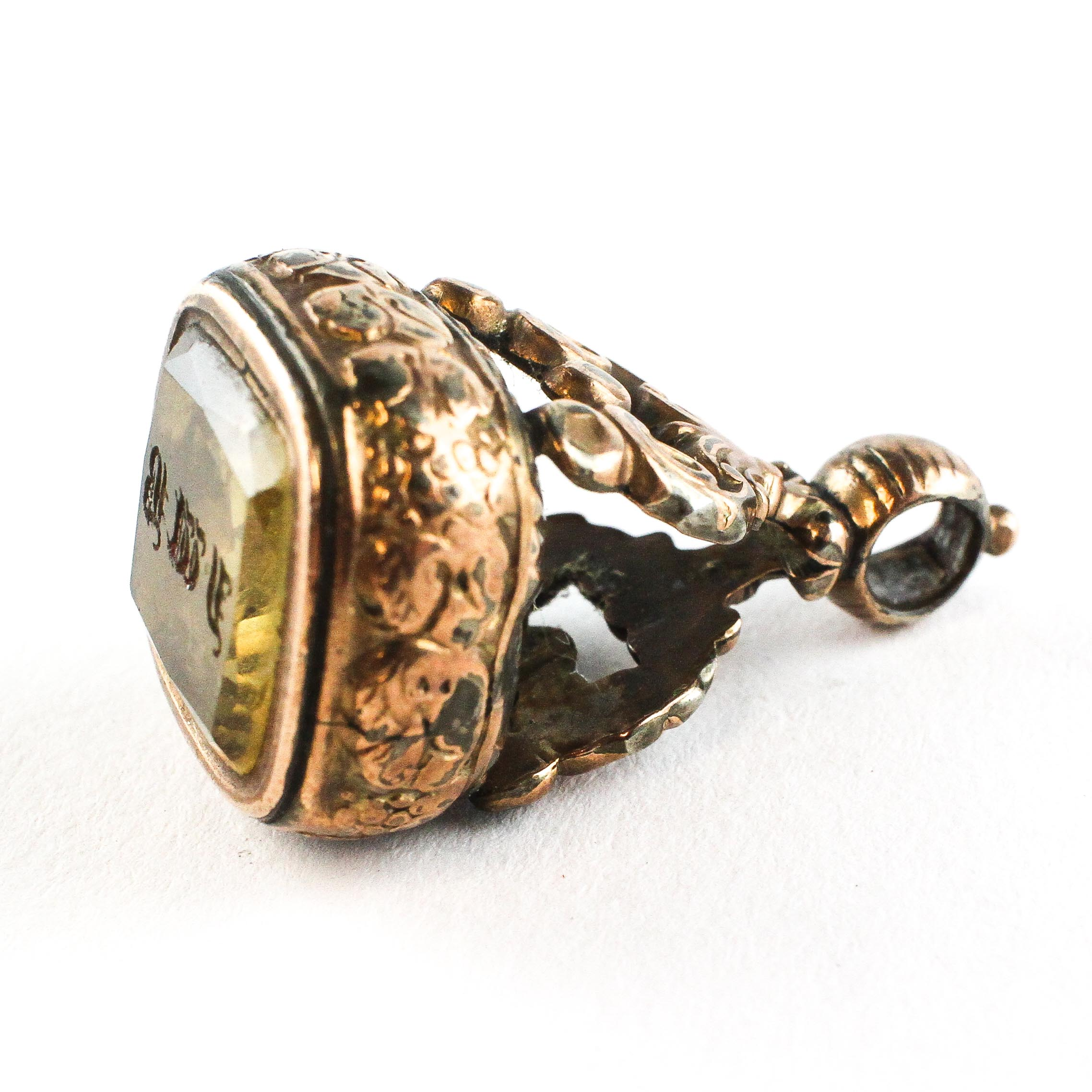 A gold plated ornate set with yellow stone. - Image 2 of 2