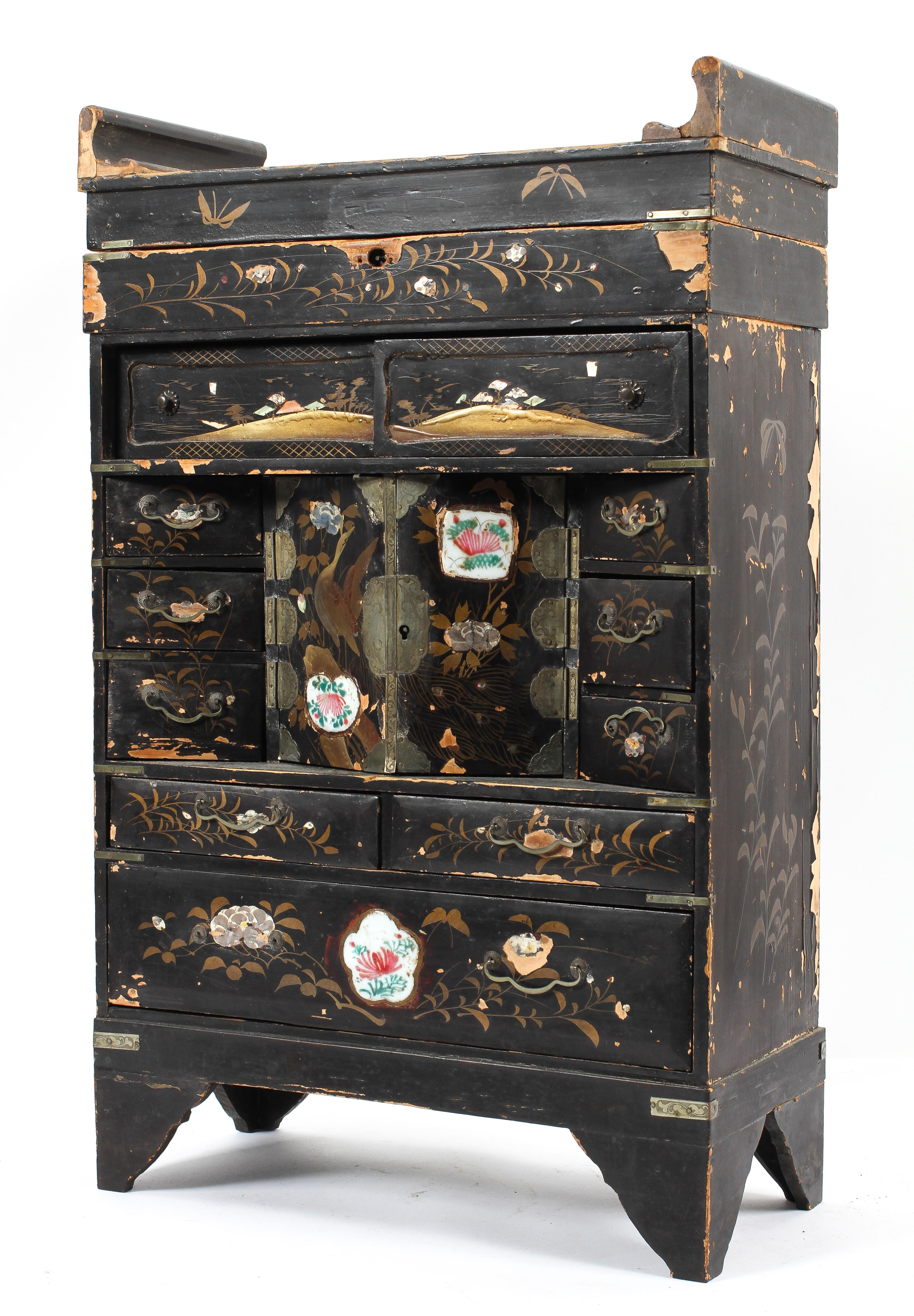 A Chinese black lacquered miniature chest, early 20th century gilt with flower and cranes,