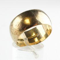 A yellow metal 10.5mm D shape wedding ring. Hallmarked 9ct gold, Birmingham.