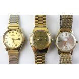 A collection of three gold plated manual wind bracelet wristwatches