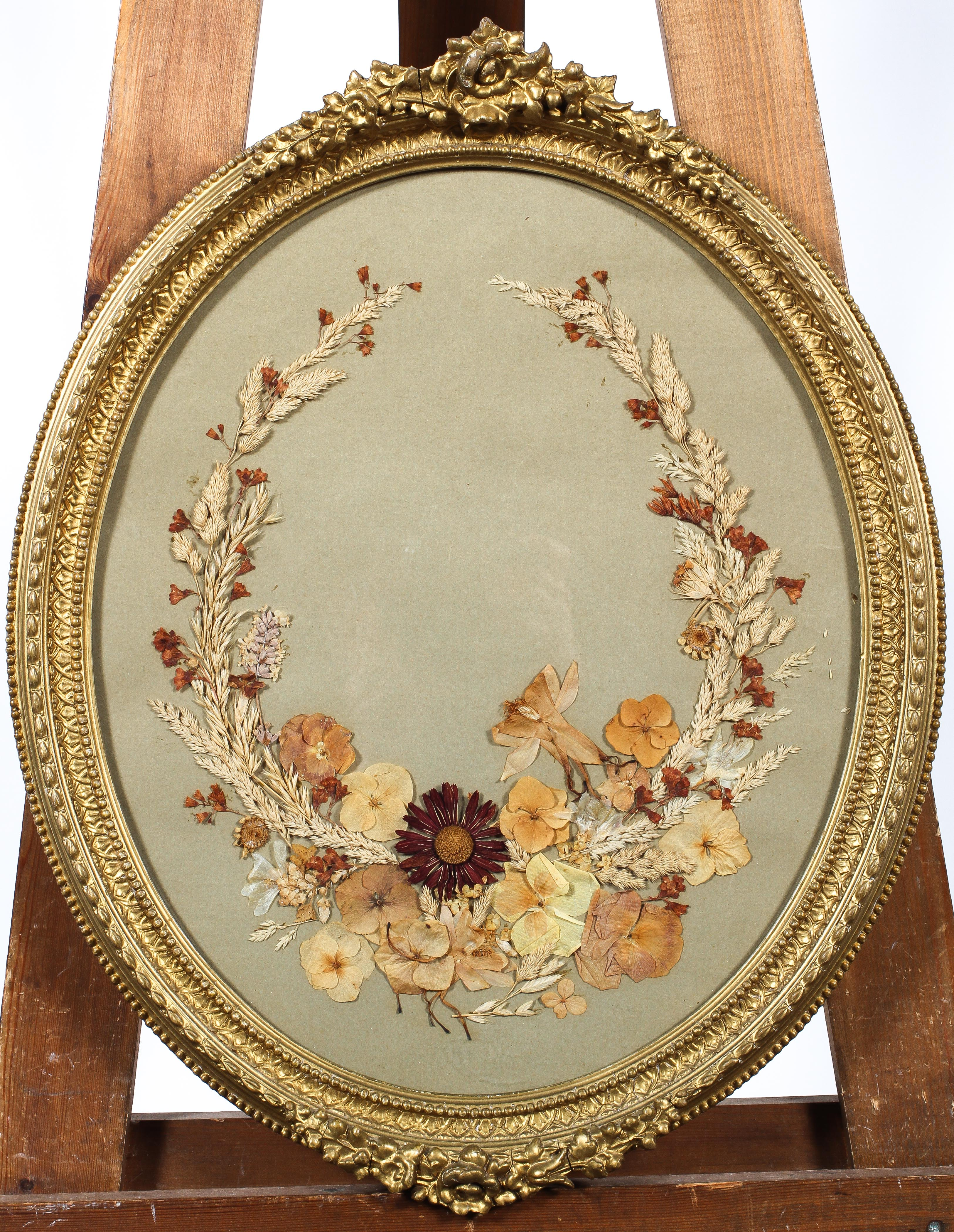A Victorian style pressed dried flower oval picture, in giltwood frame,